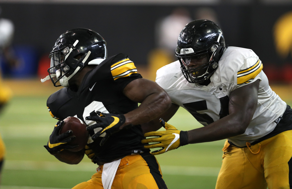 Iowa Hawkeyes running back Mekhi Sargent (10) and defensive tackle Daviyon Nixon (54) during Fall Camp Practice No. 6 Thursday, August 8, 2019 at the Ronald D. and Margaret L. Kenyon Football Practice Facility. (Brian Ray/hawkeyesports.com)