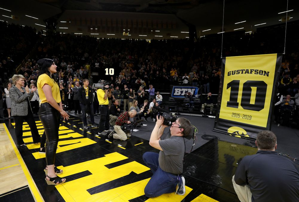 Megan Gustafson wipes away a tear as her number is raised into the rafters during a jersey retirement ceremony Sunday, January 26, 2020 at Carver-Hawkeye Arena. (Brian Ray/hawkeyesports.com)