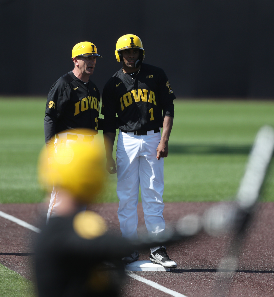 Iowa Hawkeyes infielder Lorenzo Elion (1) and head coach Rick Heller during game two against UC Irvine Saturday, May 4, 2019 at Duane Banks Field. (Brian Ray/hawkeyesports.com)