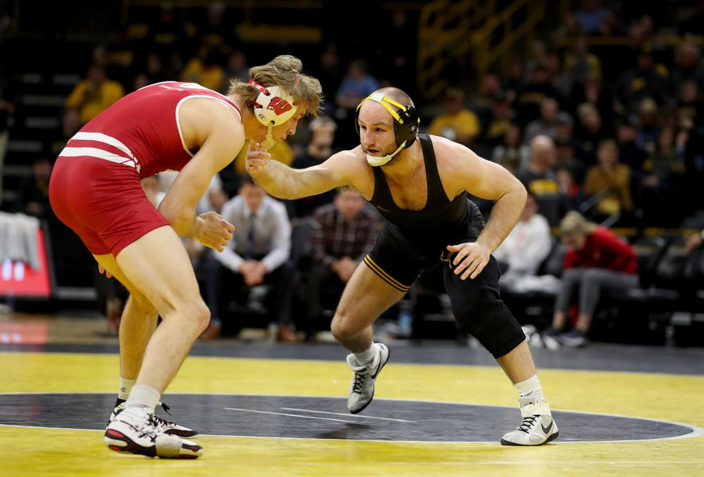 IowaÕs Alex Marinelli wrestles WisconsinÕs Evan Wick at 165 pounds Sunday, December 1, 2019 at Carver-Hawkeye Arena. Marinelli won the match 4-2. (Brian Ray/hawkeyesports.com)