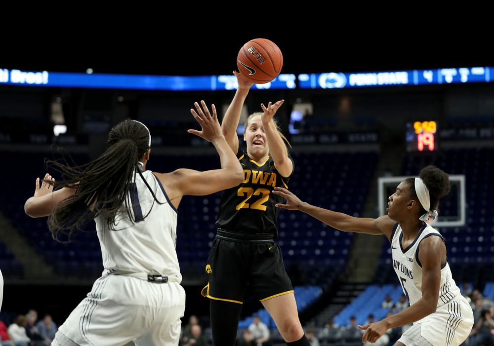 Iowa Hawkeyes guard Kathleen Doyle (22) dishes off a pass against the Penn State Nittany Lions Thursday, January 30, 2020 at the Bryce Jordan Center. (Brian Ray/hawkeyesports.com)