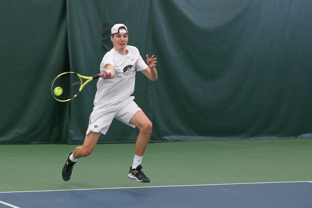 Iowa's Nikita Snezhko during the Iowa men's tennis meet vs Nebraska on Sunday, March 1, 2020 at the Hawkeye Tennis and Recreation Complex. (Lily Smith/hawkeyesports.com)