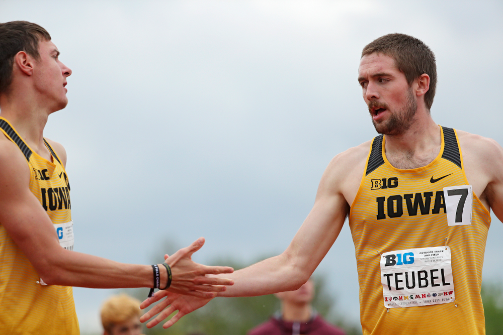 Iowa's Matt Manternach (from left) and Nolan Teubel slap hands after running the men's 800 meter event on the third day of the Big Ten Outdoor Track and Field Championships at Francis X. Cretzmeyer Track in Iowa City on Sunday, May. 12, 2019. (Stephen Mally/hawkeyesports.com)