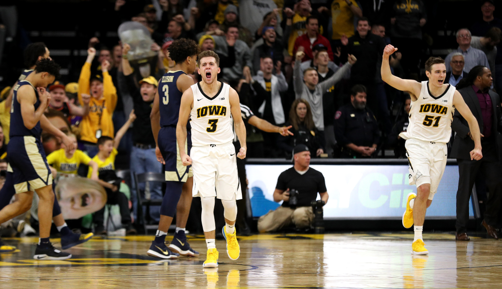 Iowa Hawkeyes guard Jordan Bohannon (3) and forward Nicholas Baer (51) celebrate their victory against the Pitt Panthers Tuesday, November 27, 2018 at Carver-Hawkeye Arena. (Brian Ray/hawkeyesports.com)