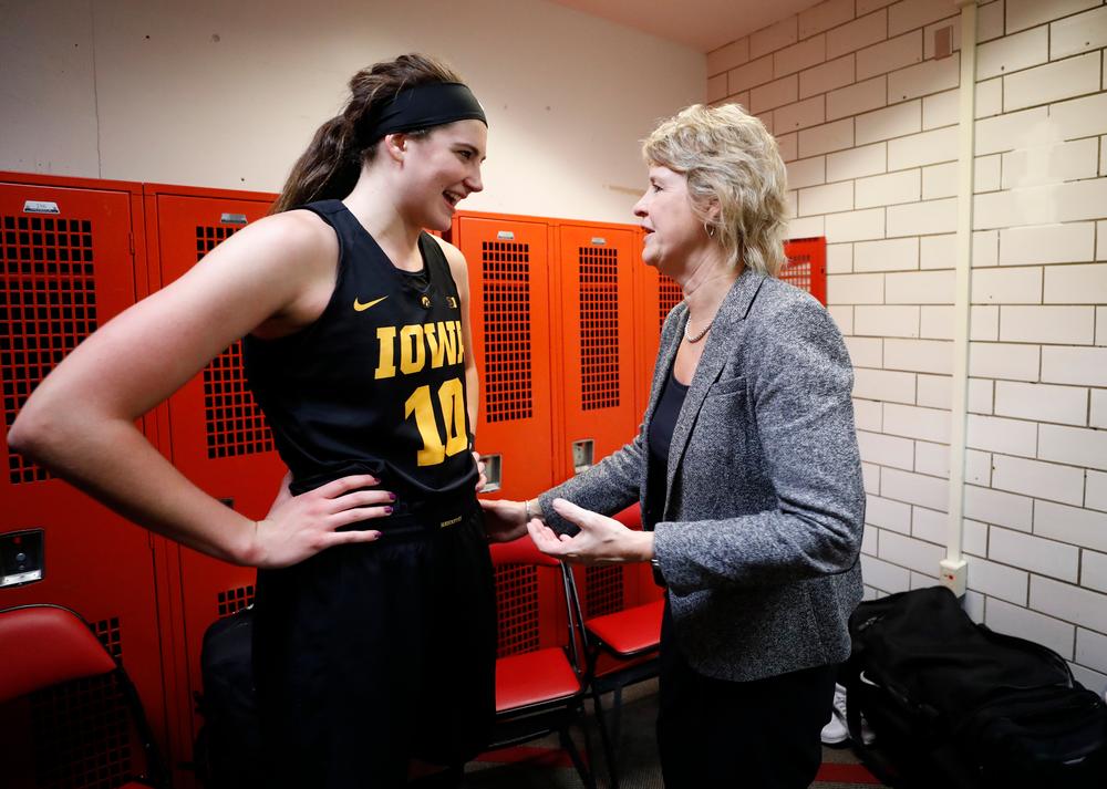 Iowa Hawkeyes forward Megan Gustafson (10) and head coach Lisa Bluder
