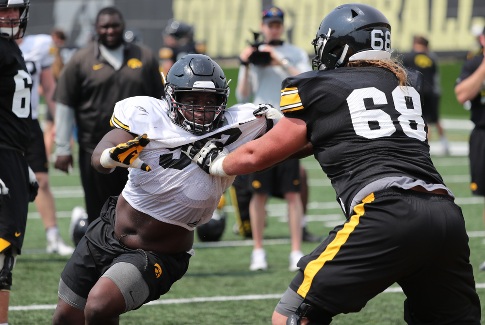 Iowa Hawkeyes defensive end Brandon Simon (93) against offensive lineman Landan Paulsen (68) during the third practice of fall camp Sunday, August 5, 2018 at the Kenyon Football Practice Facility. (Brian Ray/hawkeyesports.com)