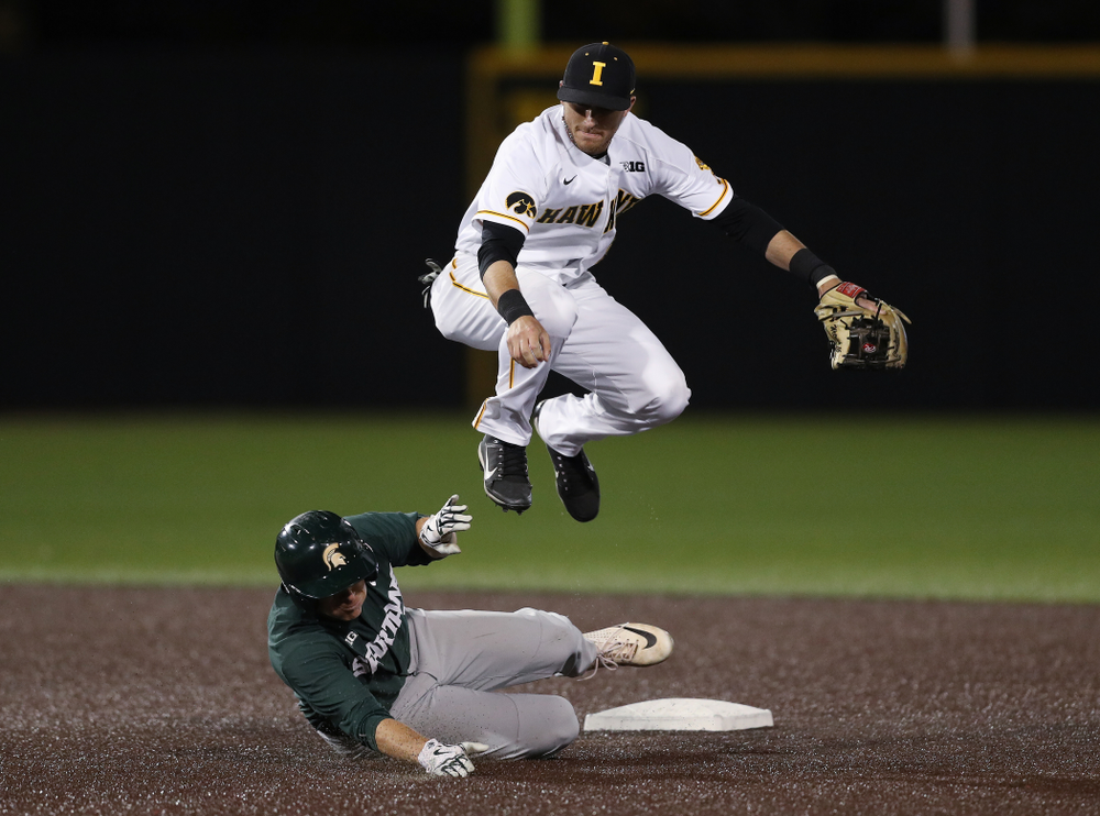 Iowa Hawkeyes Tanner Wetrich (16) turns a double play against the Michigan State Spartans Friday, May 10, 2019 at Duane Banks Field. (Brian Ray/hawkeyesports.com)