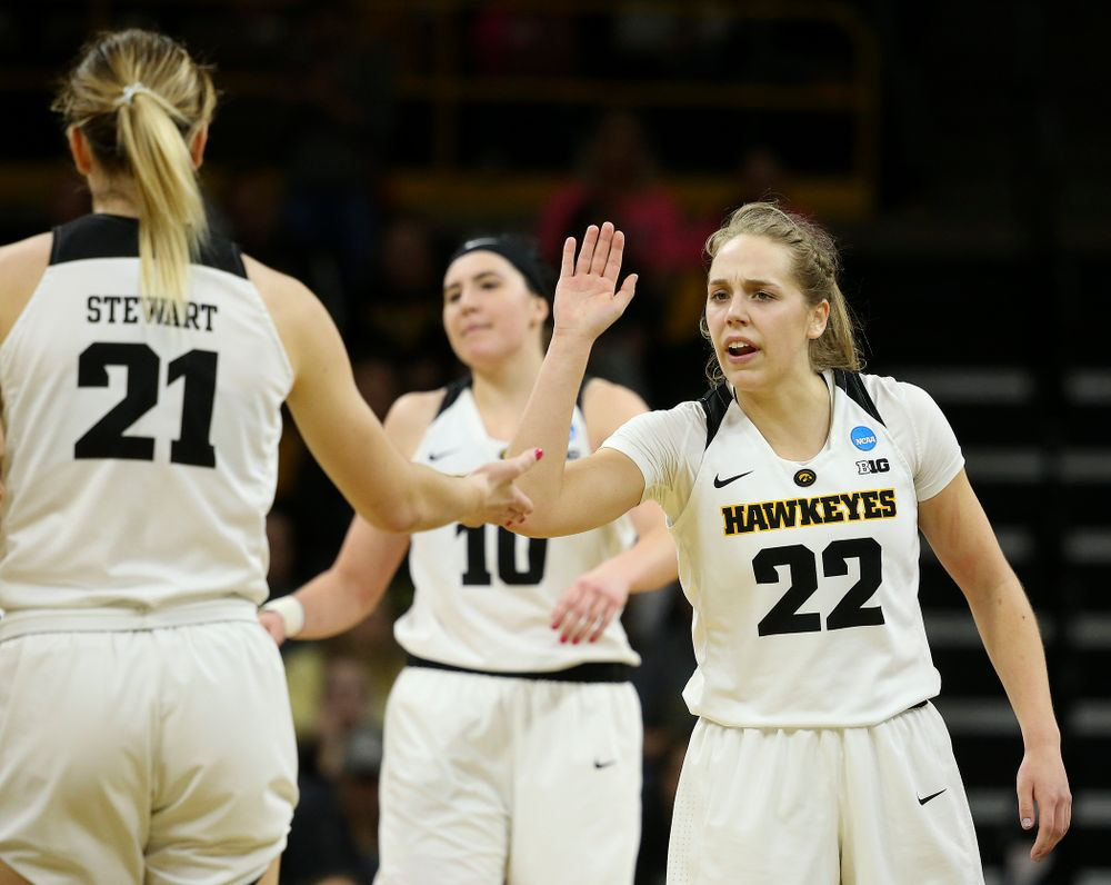 Iowa Hawkeyes guard Kathleen Doyle (22) greets forward Hannah Stewart (21) during the first round of the 2019 NCAA Women's Basketball Tournament at Carver Hawkeye Arena in Iowa City on Friday, Mar. 22, 2019. (Stephen Mally for hawkeyesports.com)