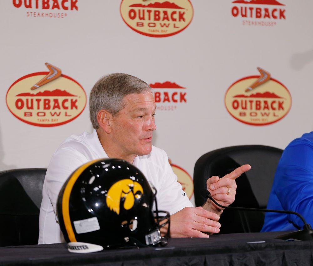 Iowa Hawkeyes head coach Kirk Ferentz and Florida Gators head Coach Jim McElwain