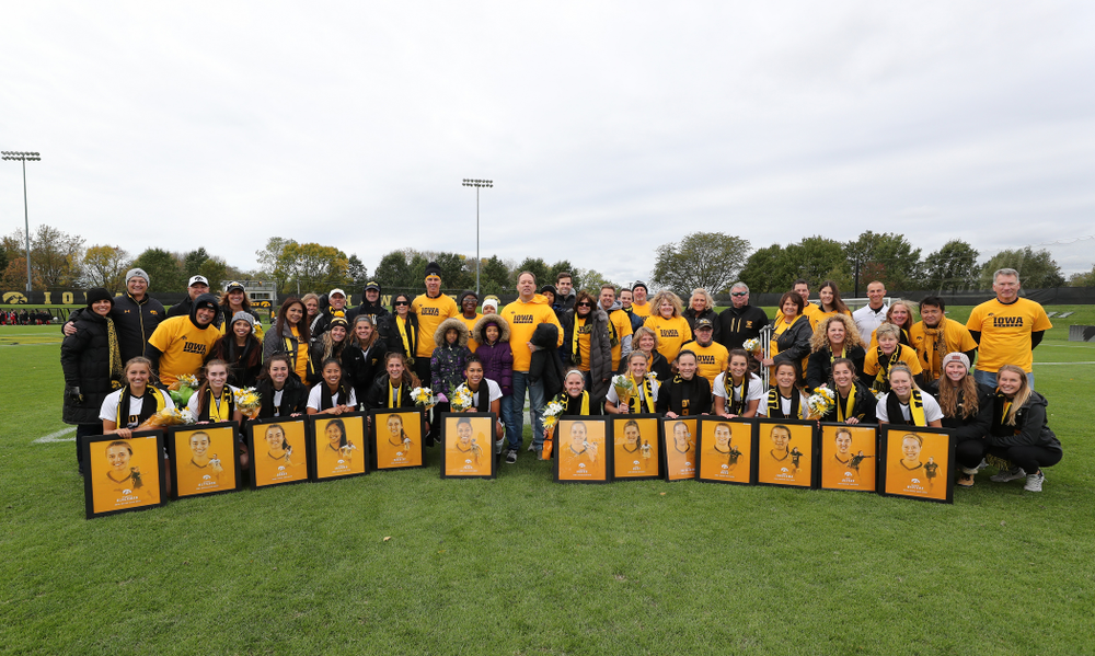 The seniors and their families pose for a photo before their game against the Maryland Terrapins Sunday, October 13, 2019 on senior day. (Brian Ray/hawkeyesports.com)