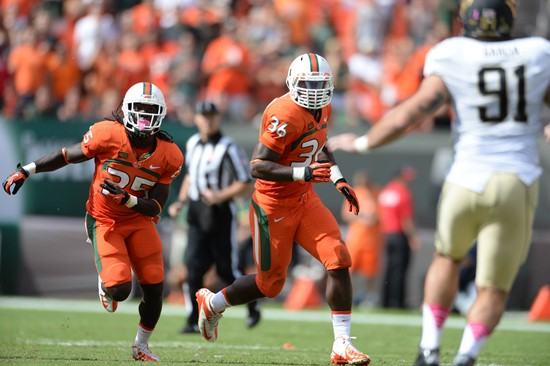 University of Miami Hurricanes linebacker Alex Figueroa #36 plays in a game against the Wake Forest Demon Deacons at Sun Life Stadium on October 26,...