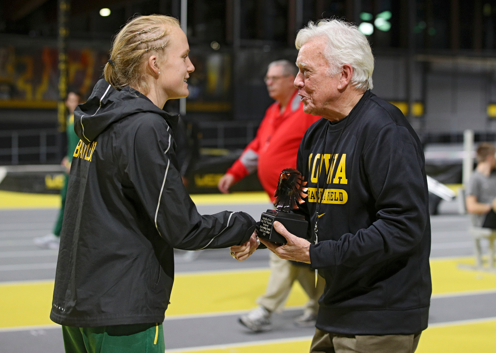 Larry Wieczorek hands out an award during the Larry Wieczorek Invitational at the Recreation Building in Iowa City on Saturday, January 18, 2020. (Stephen Mally/hawkeyesports.com)