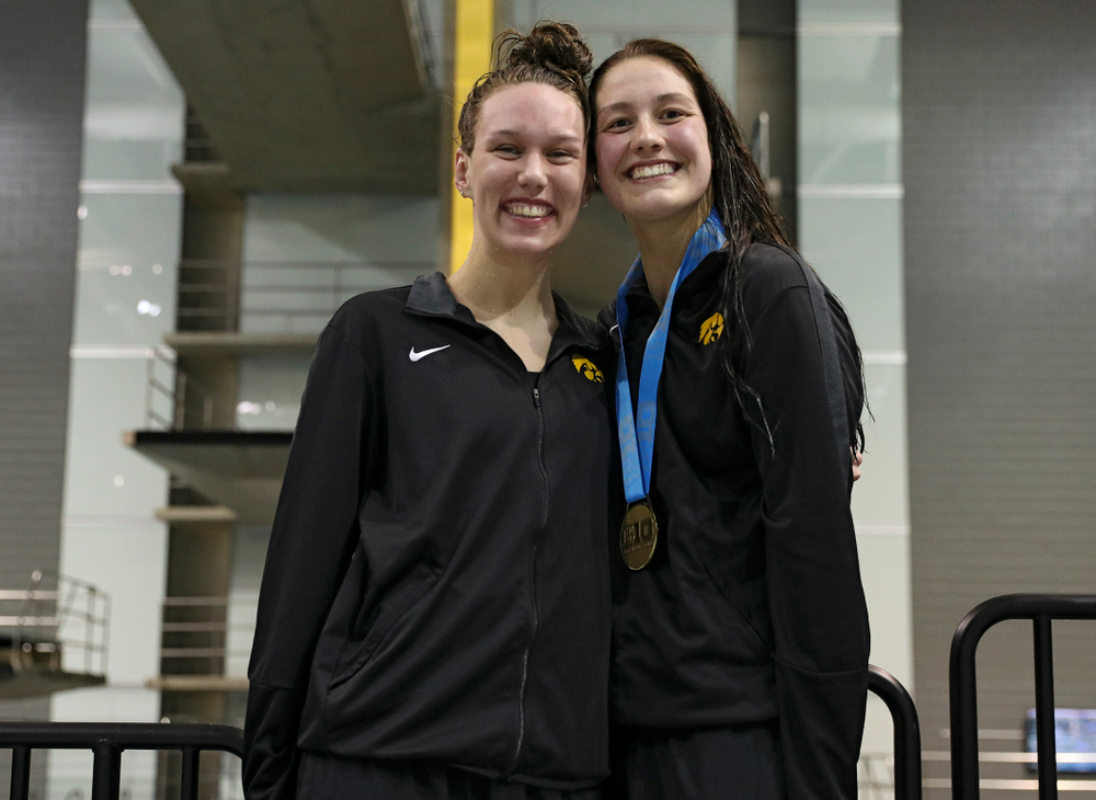 Iowa's Allyssa Fluit (from left) and Hannah Burvill on the awards stand after swimming the women's 200 yard freestyle final event during the 2020 Women's Big Ten Swimming and Diving Championships at the Campus Recreation and Wellness Center in Iowa City on Friday, February 21, 2020. (Stephen Mally/hawkeyesports.com)