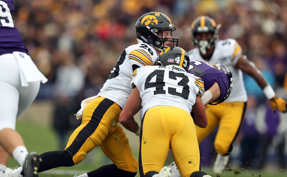 Iowa Hawkeyes defensive back Jack Koerner (28) and linebacker Dillon Doyle (43) against the Northwestern Wildcats Saturday, October 26, 2019 at Ryan Field in Evanston, Ill. (Brian Ray/hawkeyesports.com)