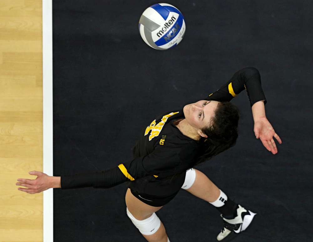 Iowa's Halle Johnston (4) serves the ball during the fourth set of their match at Carver-Hawkeye Arena in Iowa City on Friday, Nov 29, 2019. (Stephen Mally/hawkeyesports.com)