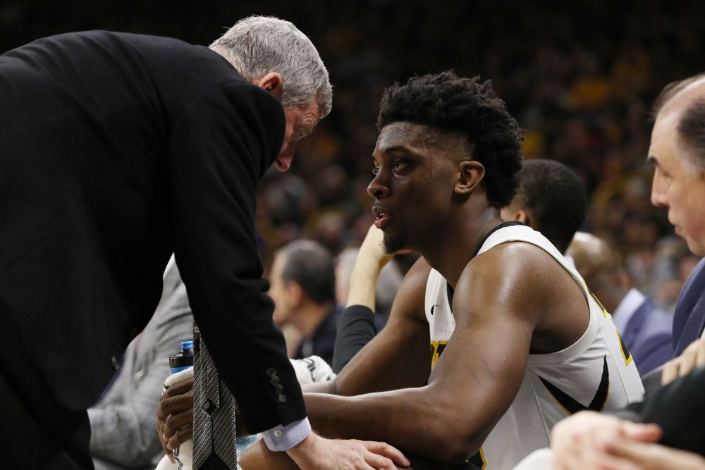 Iowa Hawkeyes forward Tyler Cook (25) and assistant coach Kirk Speraw against the Northwestern Wildcats Sunday, February 10, 2019 at Carver-Hawkeye Arena. (Brian Ray/hawkeyesports.com)