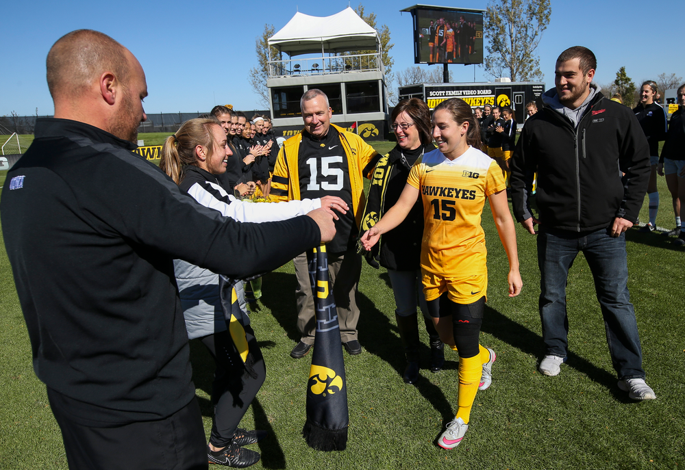 Iowa Hawkeyes forward Rose Ripslinger (15) is greeted by assistant coaches Katelyn Longino and Rade Tanaskovic during Senior Day ceremonies before a game against Northwestern at the Iowa Soccer Complex on October 21, 2018. (Tork Mason/hawkeyesports.com)