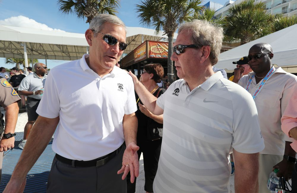 Iowa Hawkeyes head coach Kirk Ferentz and University of Iowa President Bruce Harreld during the Outback Bowl Beach Day Sunday, December 30, 2018 at Clearwater Beach. (Brian Ray/hawkeyesports.com)