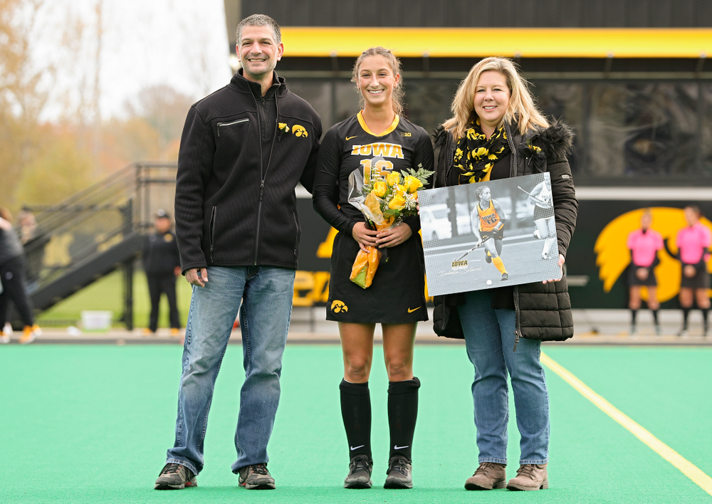 Iowa's Isabella Solaroli (16) in honored with her parents on Senior Day before their game at Grant Field in Iowa City on Saturday, Oct 26, 2019. (Stephen Mally/hawkeyesports.com)