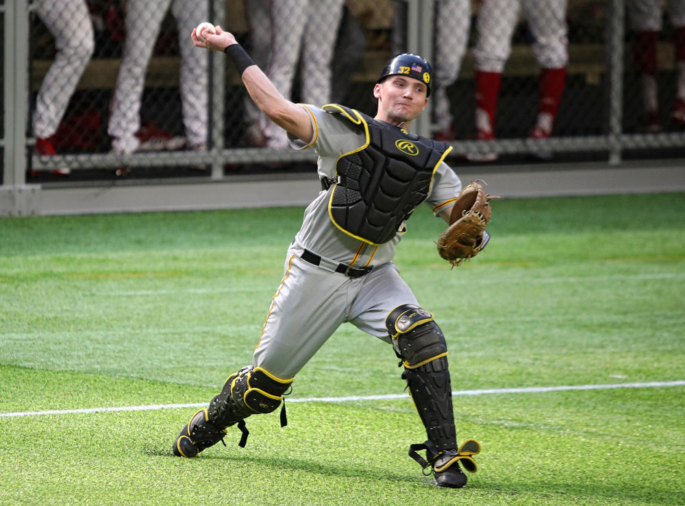 Iowa Hawkeyes catcher Brett McCleary (32) throws to first for an out during the seventh inning of their CambriaCollegeClassic game at U.S. Bank Stadium in Minneapolis, Minn. on Friday, February 28, 2020. (Stephen Mally/hawkeyesports.com)