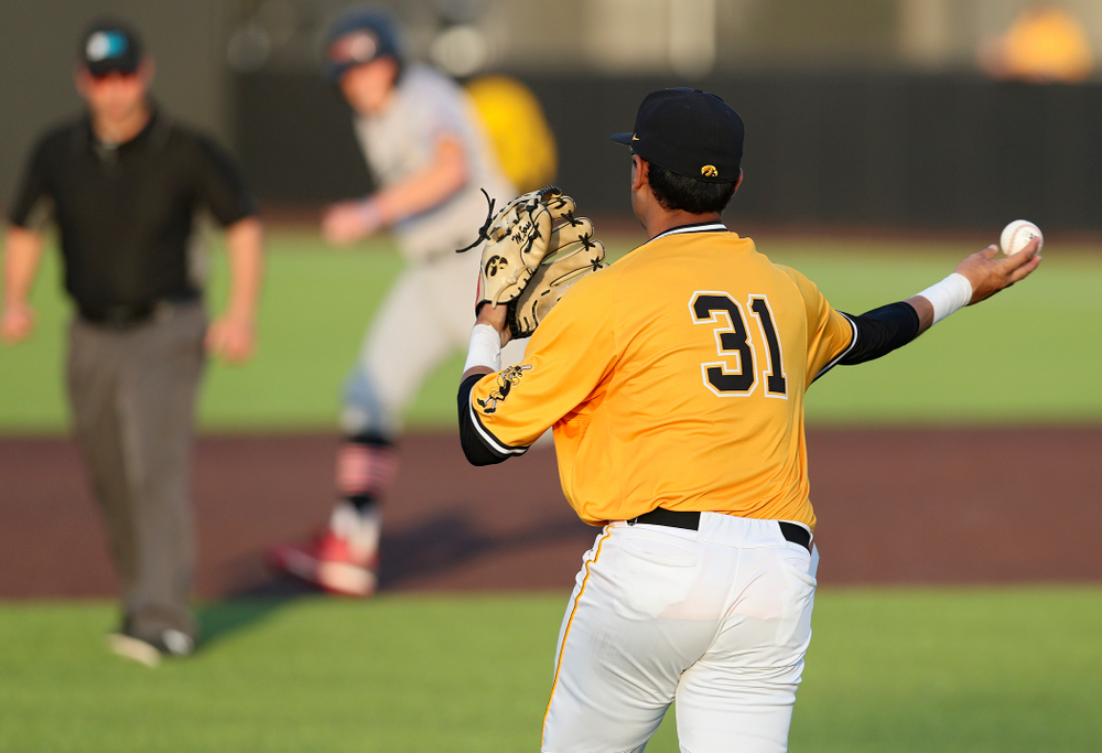 Iowa Hawkeyes shortstop Matthew Sosa (31) throws to second base to start a double play during the eighth inning of their game against Northern Illinois at Duane Banks Field in Iowa City on Tuesday, Apr. 16, 2019. (Stephen Mally/hawkeyesports.com)
