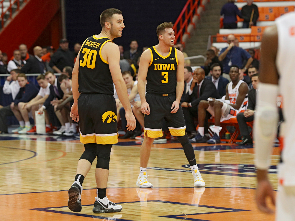 Iowa Hawkeyes guard Connor McCaffery (30) and guard Jordan Bohannon (3) are all smiles in the closing seconds of the second half of their ACC/Big Ten Challenge game at the Carrier Dome in Syracuse, N.Y. on Tuesday, Dec 3, 2019. (Stephen Mally/hawkeyesports.com)