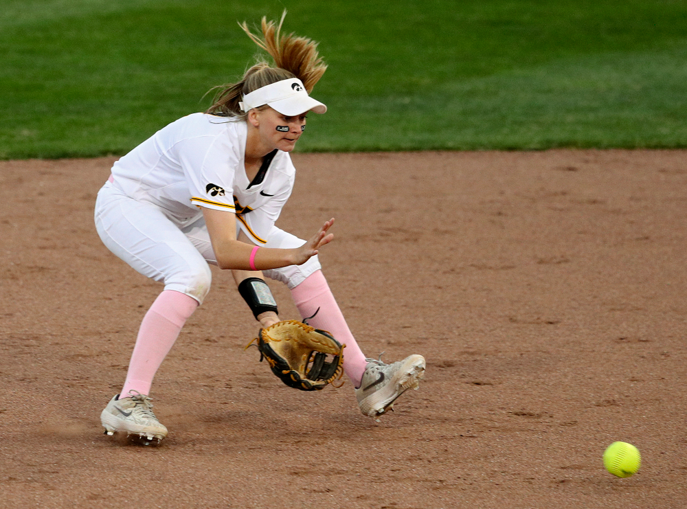 Iowa second baseman Aralee Bogar (2) fields a ground ball before throwing to first for an out during the third inning of their game against Iowa State at Pearl Field in Iowa City on Tuesday, Apr. 9, 2019. (Stephen Mally/hawkeyesports.com)