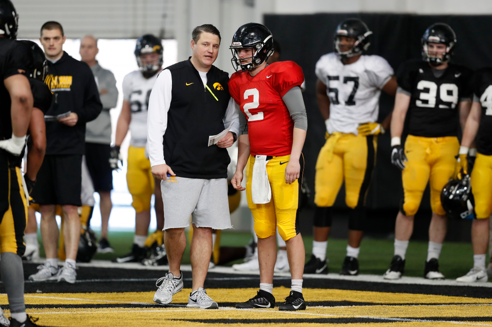 Iowa Hawkeyes offensive coordinator Brian Ferentz and quarterback Peyton Mansell (2) during spring practice Wednesday, March 28, 2018 at the Hansen Football Performance Center.  (Brian Ray/hawkeyesports.com)