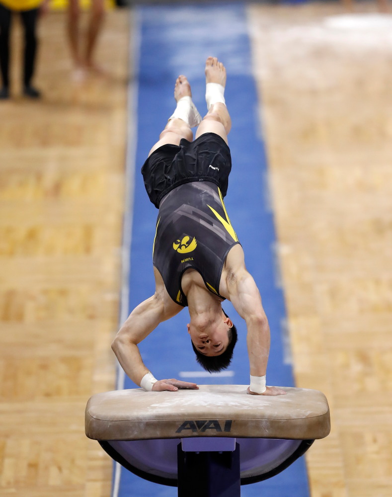 Bennet Huang competes on the vault against Illinois