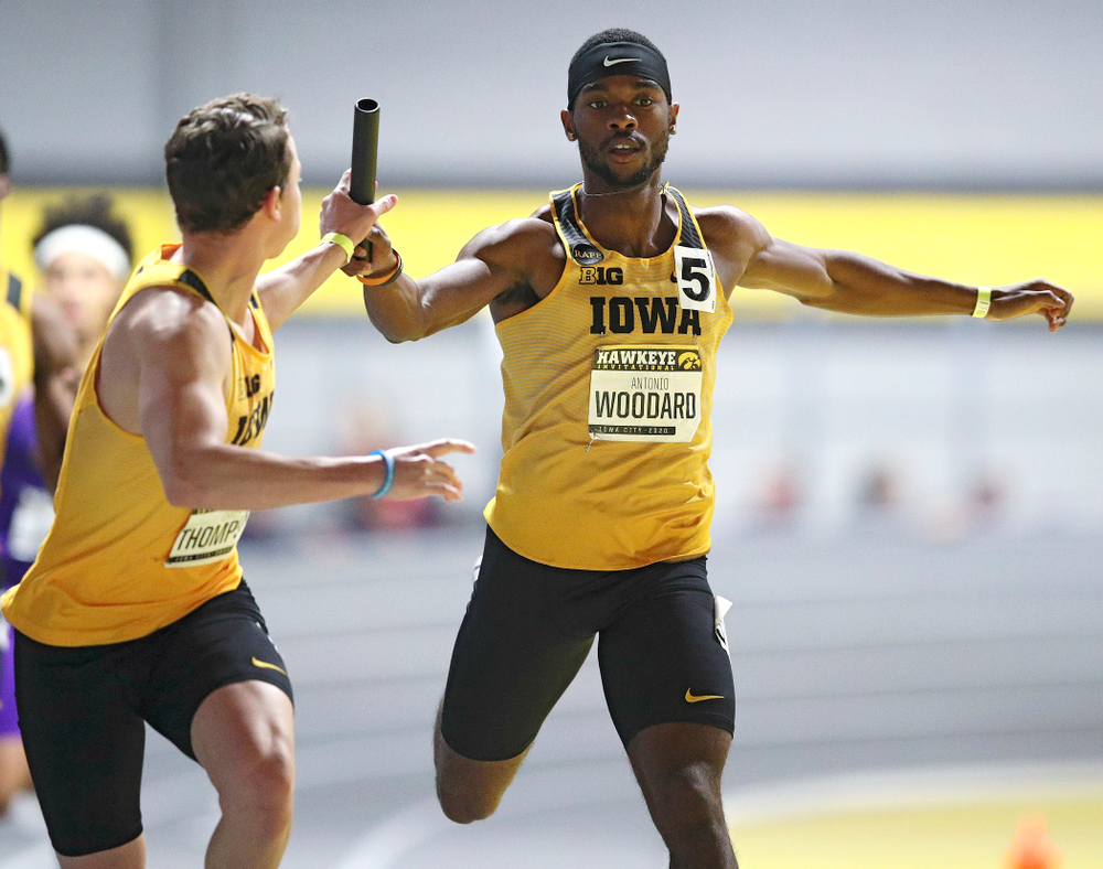 Iowa's Antonio Woodard (right) hands the baton off to Chris Thompson as they run the men's 1600 meter relay event during the Hawkeye Invitational at the Recreation Building in Iowa City on Saturday, January 11, 2020. (Stephen Mally/hawkeyesports.com)