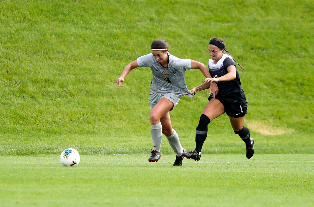 Iowa forward Kaleigh Haus (4) tries to pull away from a defender during the first half of their match at the Iowa Soccer Complex in Iowa City on Sunday, Sep 1, 2019. (Stephen Mally/hawkeyesports.com)