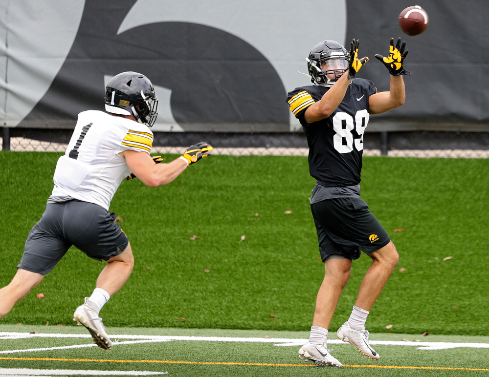 Iowa Hawkeyes wide receiver Nico Ragaini (89) pulls in a pass as defensive back Wes Dvorak (1) closes in during Fall Camp Practice No. 15 at the Hansen Football Performance Center in Iowa City on Monday, Aug 19, 2019. (Stephen Mally/hawkeyesports.com)