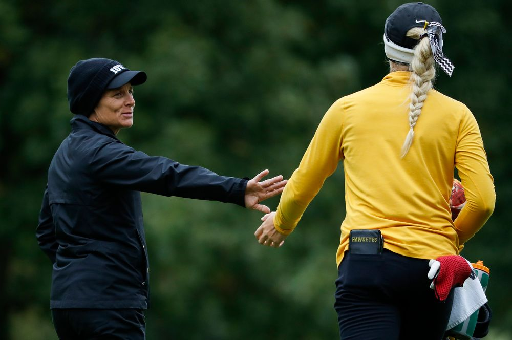 Iowa head coach Megan Menzel greets Shawn Rennegarbe as she makes her way to the eighth tee during the Diane Thomason Invitational at Finkbine Golf Course on September 29, 2018. (Tork Mason/hawkeyesports.com)