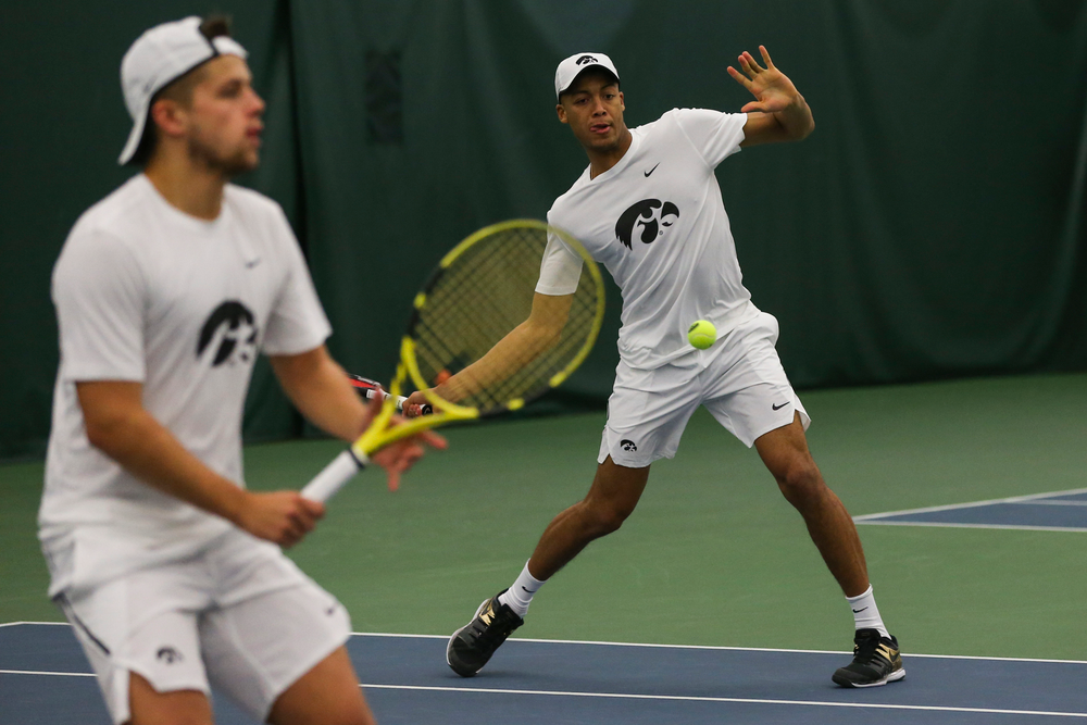 Iowa's Oliver Okonkwo hits a forehand during the Iowa men's tennis match vs Western Michigan on Saturday, January 18, 2020 at the Hawkeye Tennis and Recreation Complex. (Lily Smith/hawkeyesports.com)