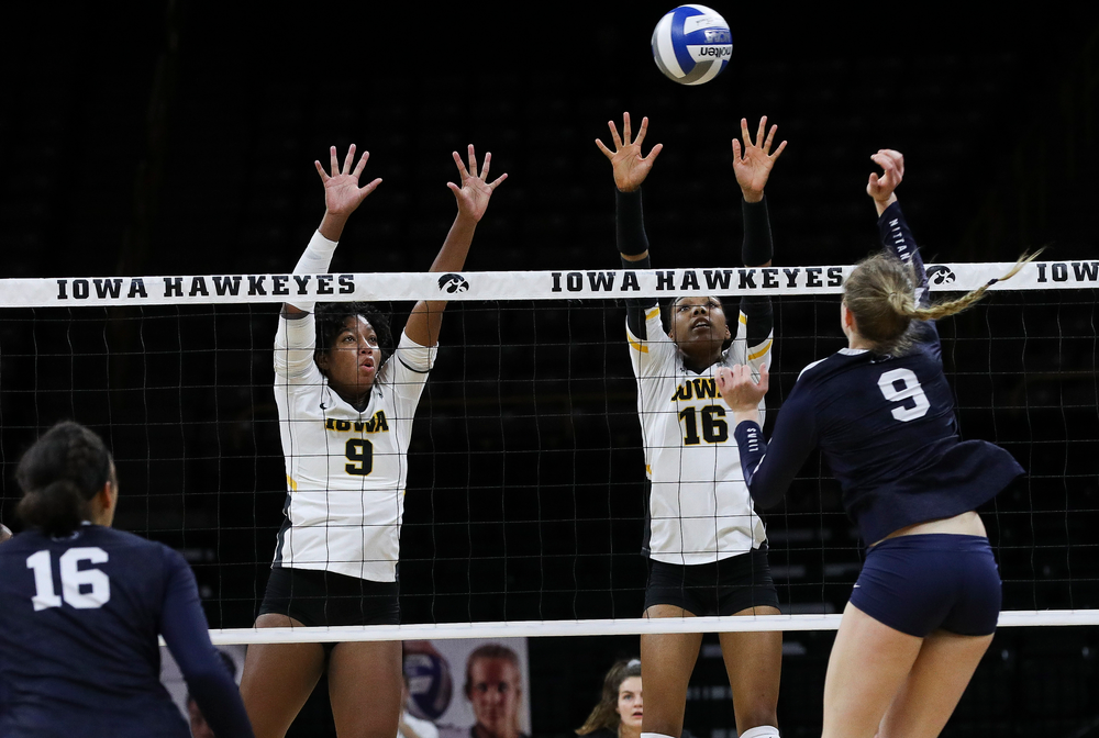 Iowa Hawkeyes middle blocker Amiya Jones (9) and Iowa Hawkeyes outside hitter Taylor Louis (16) go up for a block during a match against Penn State at Carver-Hawkeye Arena on November 3, 2018. (Tork Mason/hawkeyesports.com)