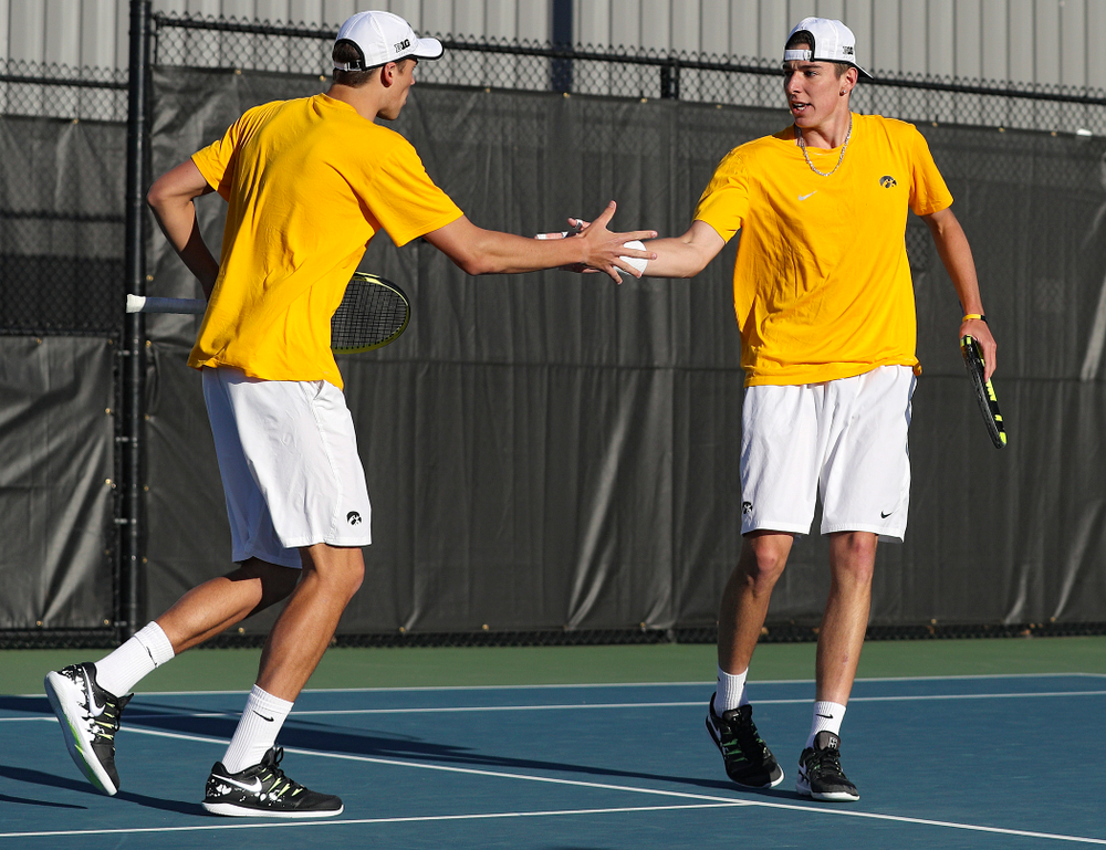 Iowa's Joe Tyler (from left) and Nikita Snezhko celebrate a point during their doubles match again Michigan State at the Hawkeye Tennis and Recreation Complex in Iowa City on Friday, Apr. 19, 2019. (Stephen Mally/hawkeyesports.com)