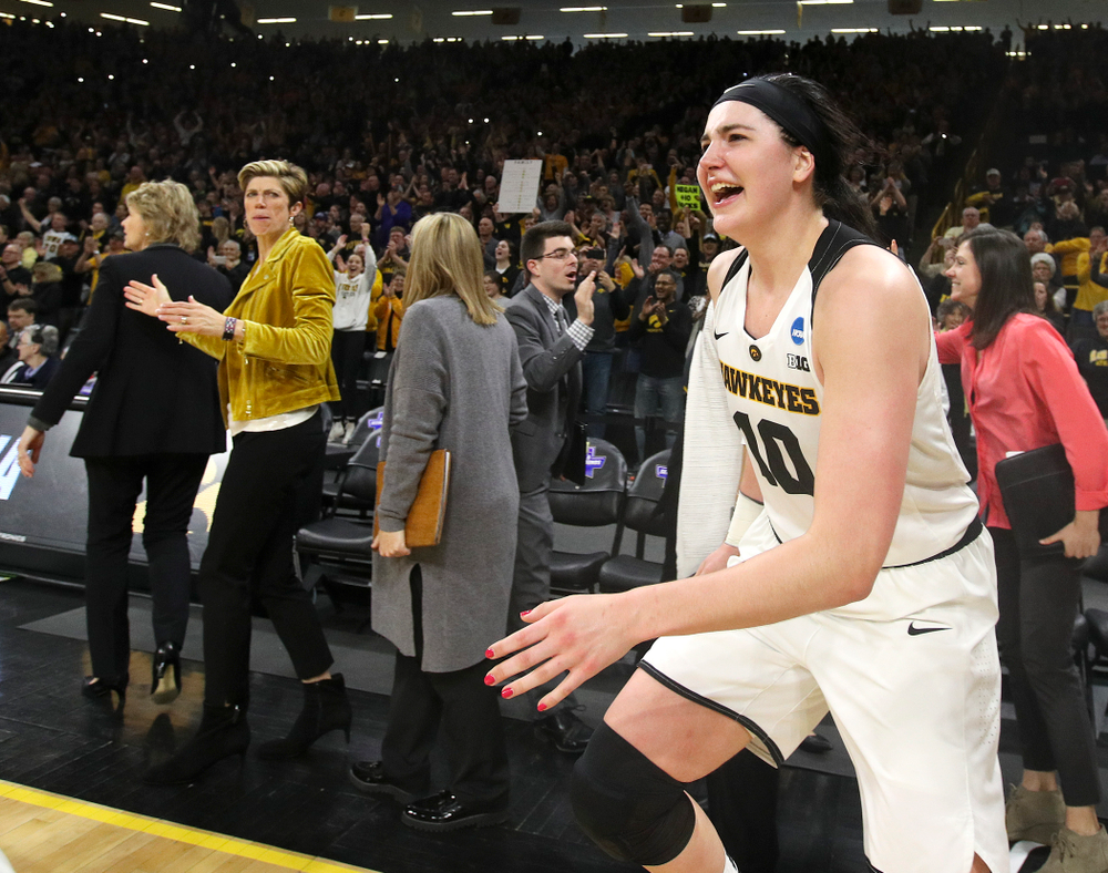 Iowa Hawkeyes center Megan Gustafson (10) runs onto the court after winning their second round game in the 2019 NCAA Women's Basketball Tournament at Carver Hawkeye Arena in Iowa City on Sunday, Mar. 24, 2019. (Stephen Mally for hawkeyesports.com)