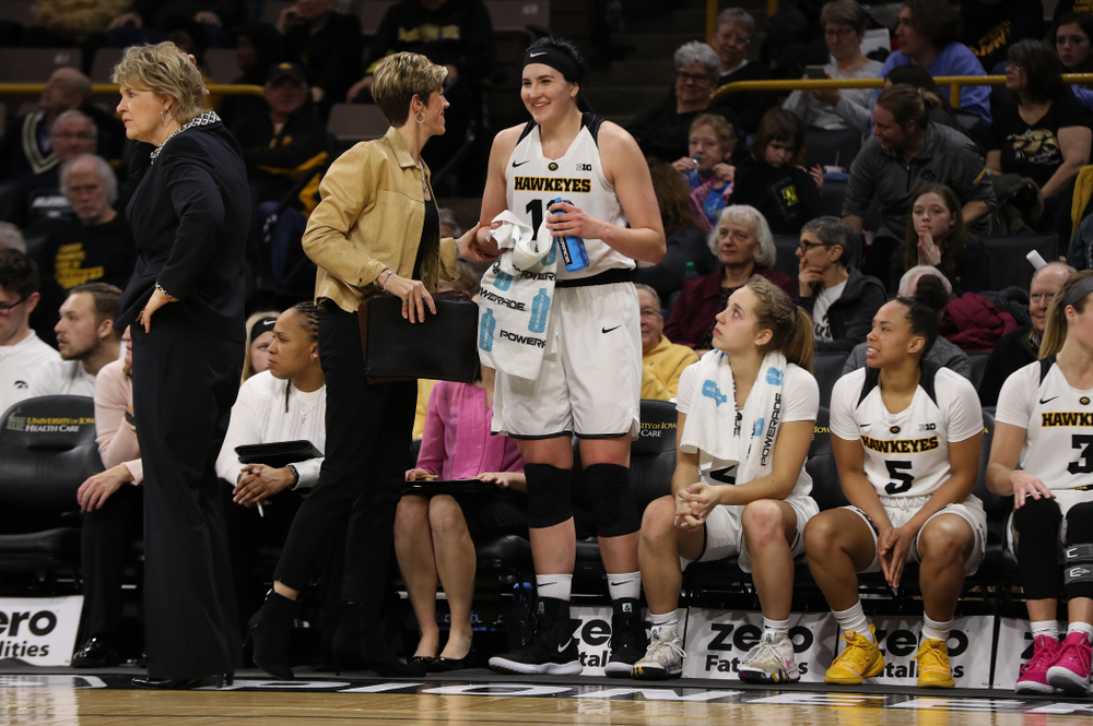 Associate head coach Jan Jensen  and forward Megan Gustafson (10) against the Illinois Fighting Illini Thursday, February 14, 2019 at Carver-Hawkeye Arena. (Brian Ray/hawkeyesports.com)