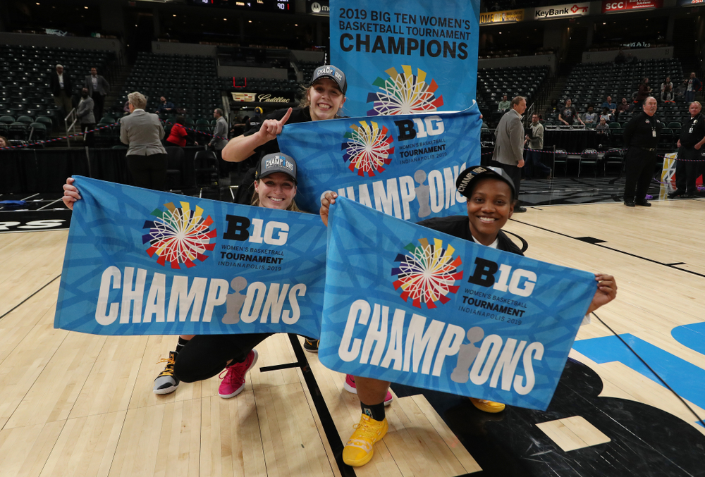 Iowa Hawkeyes guard Kathleen Doyle (22), guard Makenzie Meyer (3), and guard Zion Sanders (24)  celebrate their victory over the Maryland Terrapins in the Big Ten Championship Game Sunday, March 10, 2019 at Bankers Life Fieldhouse in Indianapolis, Ind. (Brian Ray/hawkeyesports.com)