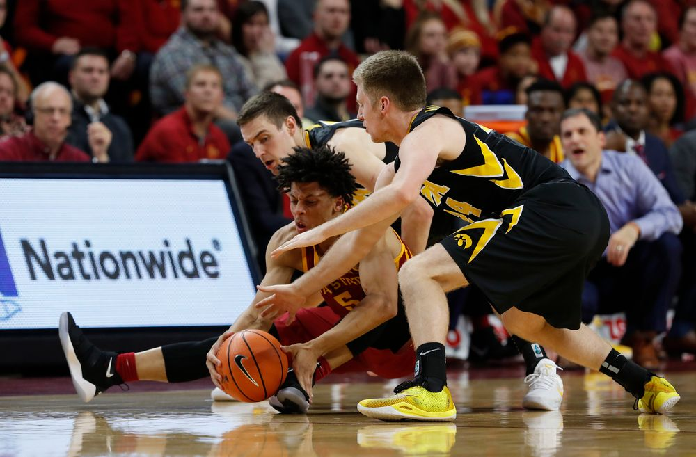 Iowa Hawkeyes guard Brady Ellingson (24) and forward Nicholas Baer (51)