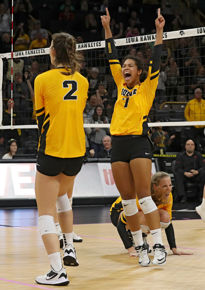 Iowa's Courtney Buzzerio (2), Brie Orr (7), and Hannah Clayton (18) celebrate a score during their match at Carver-Hawkeye Arena in Iowa City on Sunday, Oct 20, 2019. (Stephen Mally/hawkeyesports.com)