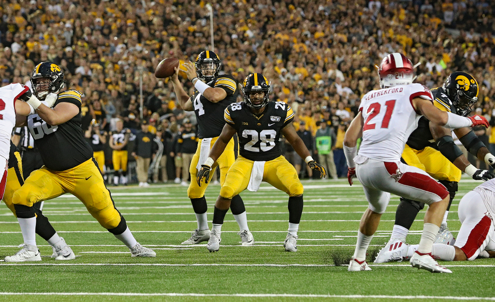 Iowa Hawkeyes quarterback Nate Stanley (4) throws a 9-yard touchdown pass during the second quarter of their game at Kinnick Stadium in Iowa City on Saturday, Aug 31, 2019. (Stephen Mally/hawkeyesports.com)