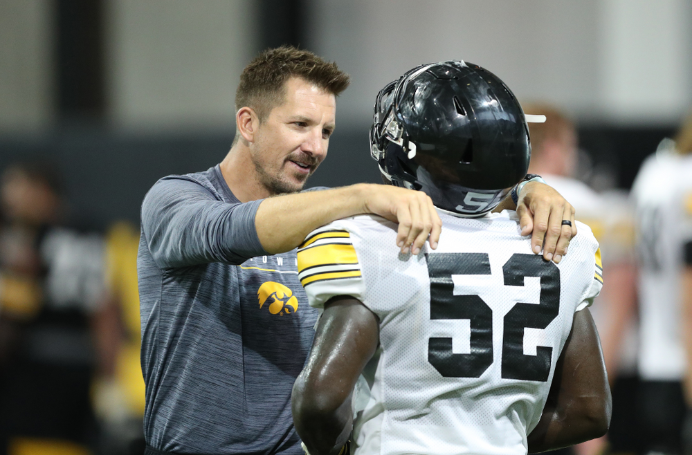 Dallas Clark and Iowa Hawkeyes linebacker Amani Jones (52)during Fall Camp Practice No. 16 Tuesday, August 20, 2019 at the Ronald D. and Margaret L. Kenyon Football Practice Facility. (Brian Ray/hawkeyesports.com)
