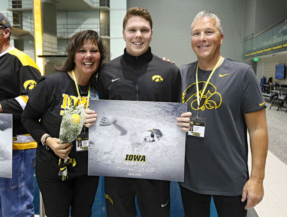 Iowa's Forrest White is honored on senior day before their meet at the Campus Recreation and Wellness Center in Iowa City on Friday, February 7, 2020. (Stephen Mally/hawkeyesports.com)