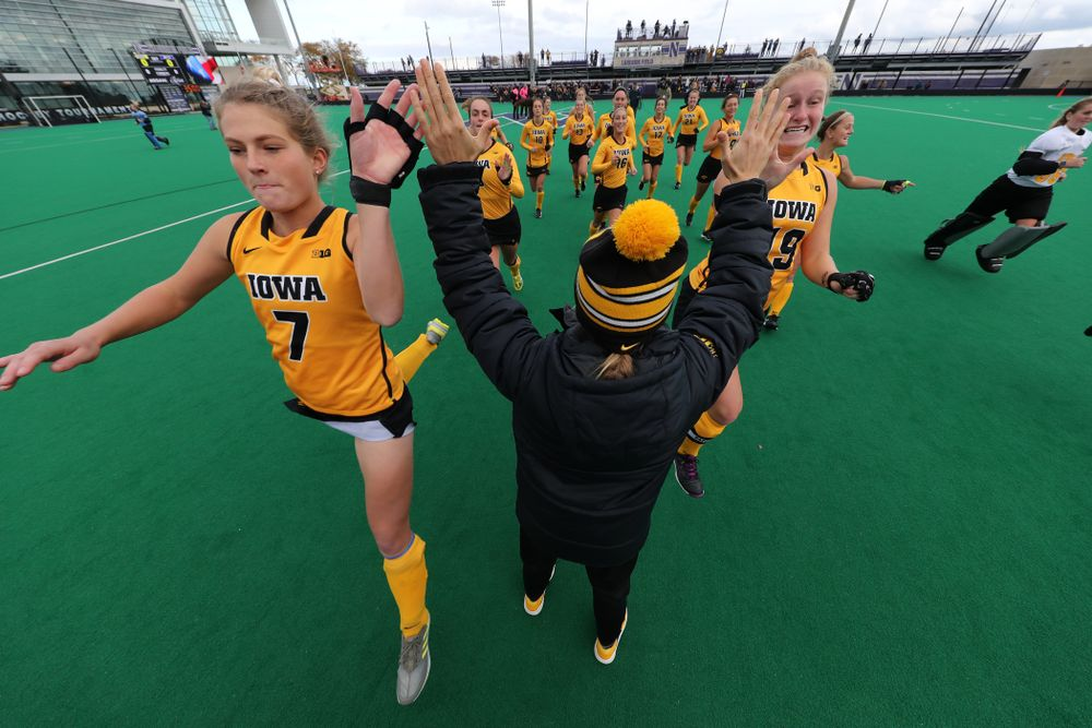 Iowa Hawkeyes Ellie Holley (7) and Ryley Miller (19) high five assistant coach Roz Ellis before their game against the Michigan Wolverines in the semi-finals of the Big Ten Tournament Friday, November 2, 2018 at Lakeside Field on the campus of Northwestern University in Evanston, Ill. (Brian Ray/hawkeyesports.com)