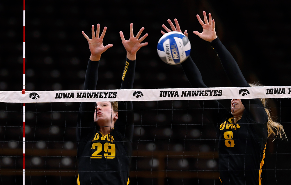 Iowa Hawkeyes Jess Janota (29) and Reghan Coyle (8)