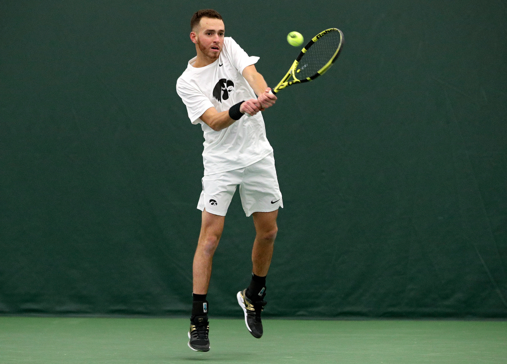 Iowa's Kareem Allaf returns a shot during his doubles match at the Hawkeye Tennis and Recreation Complex in Iowa City on Sunday, February 16, 2020. (Stephen Mally/hawkeyesports.com)