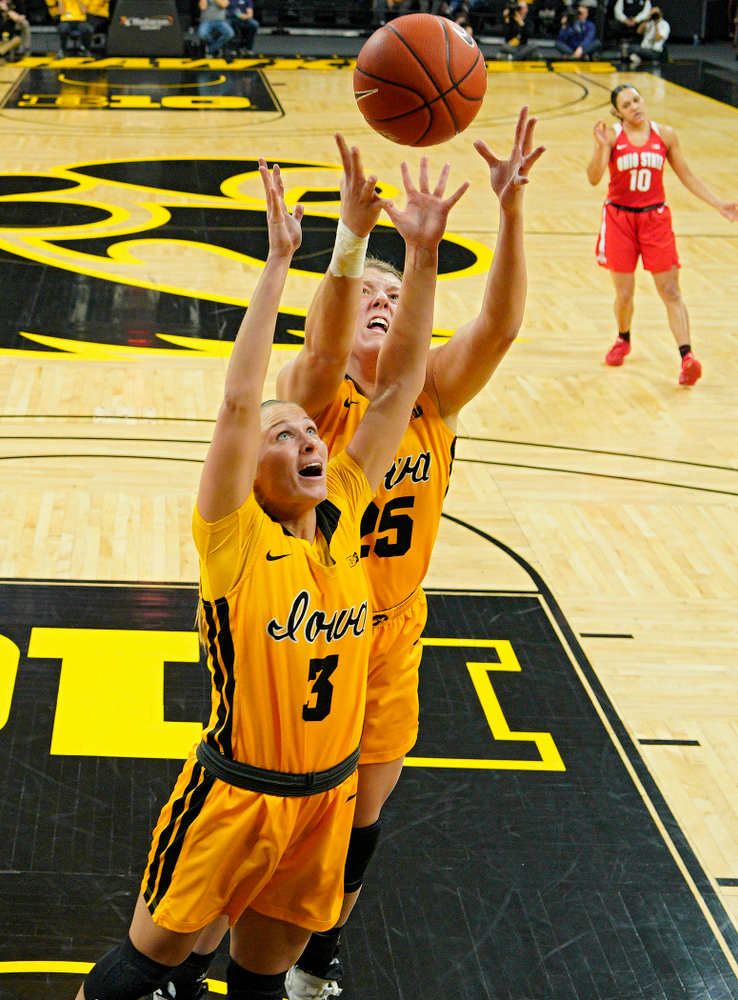 Iowa Hawkeyes guard Makenzie Meyer (3) and forward Monika Czinano (25) prepare to pull in a rebound during the third quarter of their game at Carver-Hawkeye Arena in Iowa City on Thursday, January 23, 2020. (Stephen Mally/hawkeyesports.com)