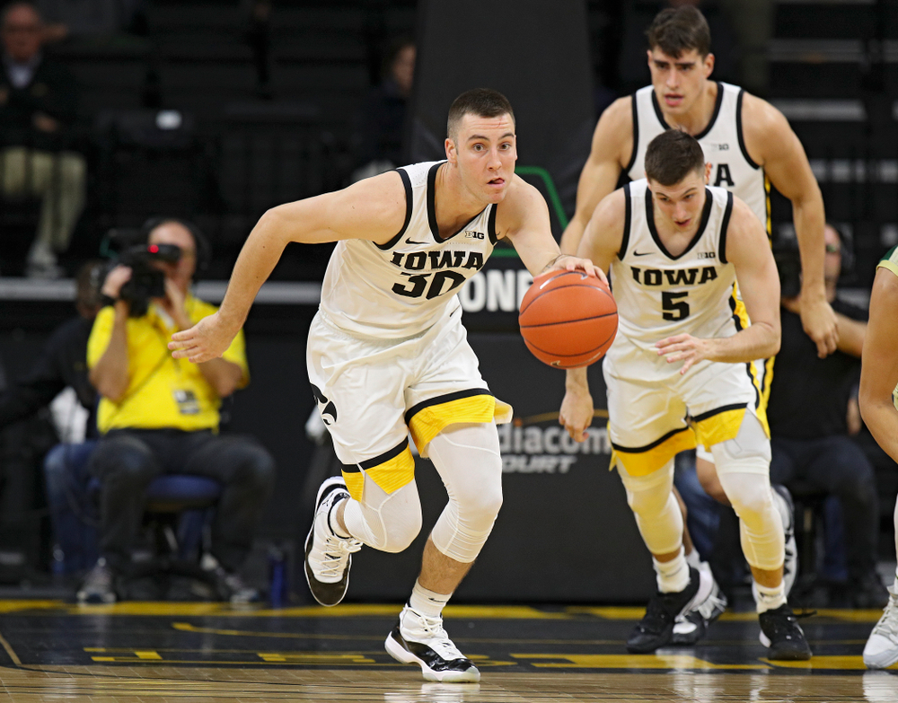 Iowa Hawkeyes guard Connor McCaffery (30) pushes the ball down the court as guard CJ Fredrick (5) and center Luka Garza (55) follow during the first half of their game at Carver-Hawkeye Arena in Iowa City on Sunday, Nov 24, 2019. (Stephen Mally/hawkeyesports.com)