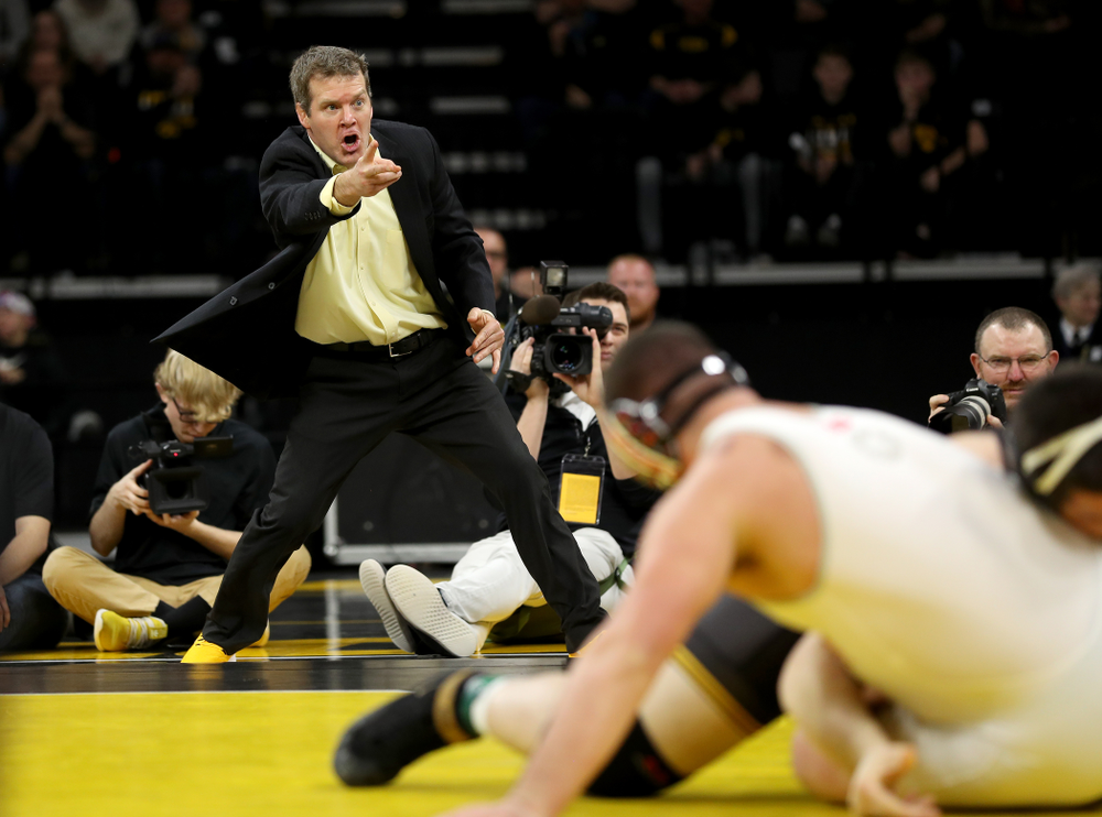 Iowa head coach Tom Brands looks for a takedown as Tony Cassioppi wrestles Ohio State's Gary Traub at heavyweight Friday, January 24, 2020 at Carver-Hawkeye Arena. Cassioppi won the match 9-3. (Brian Ray/hawkeyesports.com)